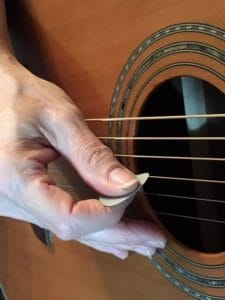 How to hold a guitar pick for speed to