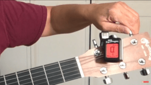 how to tune a guitar with a tuner