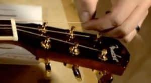 attaching guitar strings at the machine head