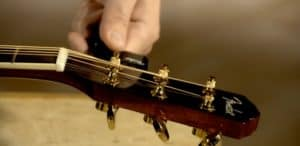 How to replace the guitar strings on an acoustic guitar