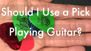 Should I use a pick playing guitar
